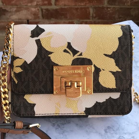 923ee3d53406 Michael Kors Tina small floral flap clutch bag